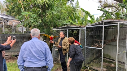 The Travato gathering admires the macaws!