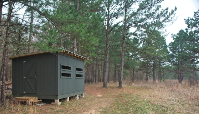 Thought this was a deer blind...until I saw the plague inside: bird watching blind built by Eagle Scouts.