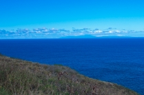 Faint outlines in the distance are the islands of Molokai and Maui behind