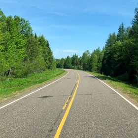 Deep in the national forest on a two-lane highway carved out of the woods