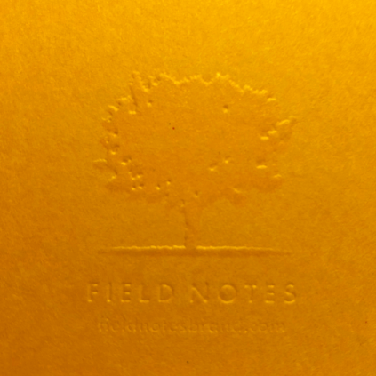 Back cover eye candy sweet: embossed tree and logo slug.